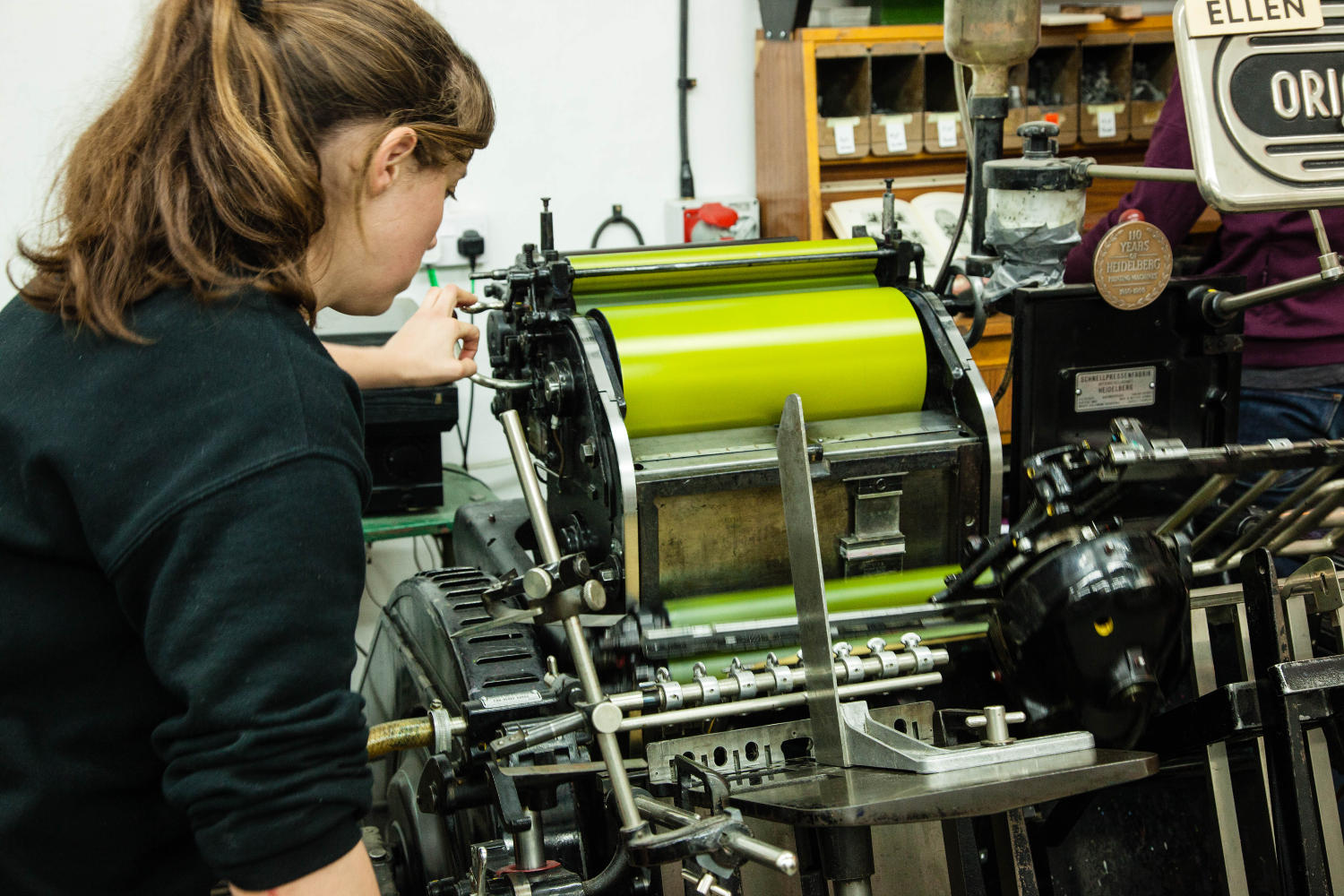 Ellen running a bright green press