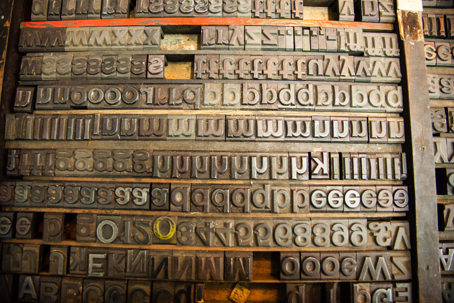 dozens of metal letters ready stacked up