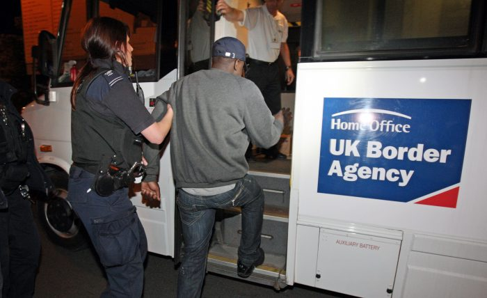Person being escorted on to a uk border agency coach