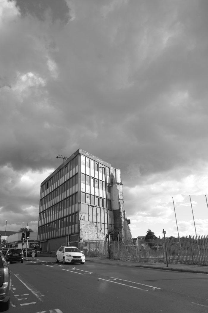 tower block against rain clouds
